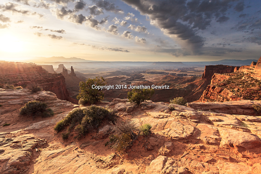 Early morning view from the top of Mesa Arch to the surrounding desert lowlands, Canyonlands National Park, Utah.<br /> <br /> WATERMARKS WILL NOT APPEAR ON PRINTS OR LICENSED IMAGES.<br /> <br /> Licensing: https://tandemstock.com/assets/81409085