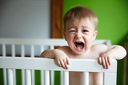Baby Boy Standing in Crib Screaming