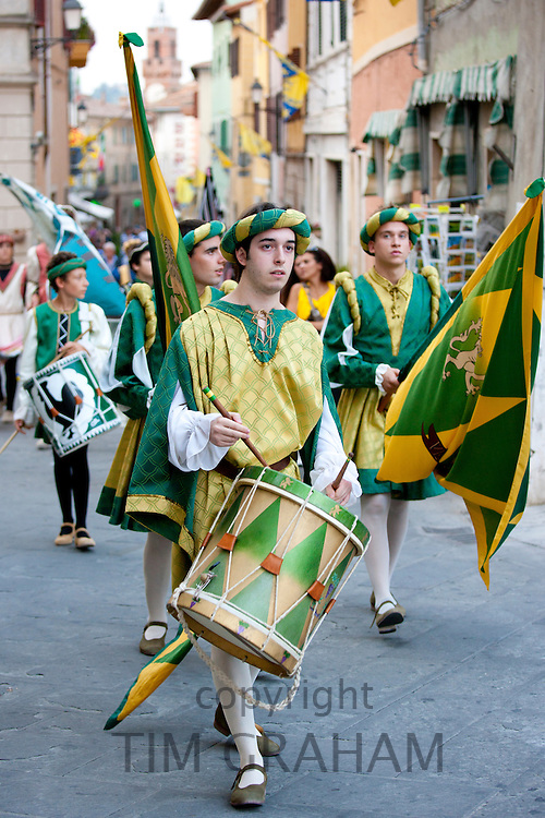 Contrada members in livery costumes for traditional parade in Asciano, inTuscany, Italy RESERVED USE - NOT FOR DOWNLOAD - FOR USE CONTACT TIM GRAHAM