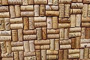 Wine bottle corks glue to a flat surface become a hot pad for the kitchen.