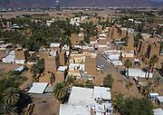 SAUDI ARABIA FROM ABOVE<br /> An ancient village with traditional mud houses near the southwestern city of Najran. An increasing number of these mud houses have been abandoned in favor of modern ones, but Saudi families like keeping them for weekend getaways or social events such as weddings or Ramadan gatherings. This frequent use means that these 200-year- old houses remain well-maintained. Many Saudis also like building a modern house close to their old family one.