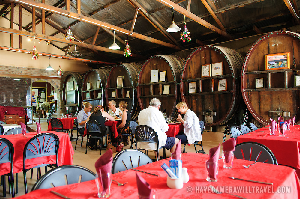 Interior of the cafe at the Ballandean Estate Winery with large oak barrels lining the wall