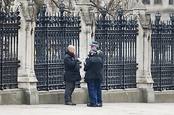 © Licensed to London News Pictures.23/03/2017.London, UK. Police stand at the spot where 24 hours earlier a terrorist crashed his car into railings surrounding Parliament. A lone terrorist killed 4 people and injured several more, in an attack using a car and a knife at Parliament and on Westminster Bridge yesterday. The attacker managed to gain entry to the grounds of the Houses of Parliament, killing one police officer.Photo credit: Peter Macdiarmid/LNP
