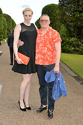 GWENDOLINE CHRISTIE and GILES DEACON at The Ralph Lauren & Vogue Wimbledon Summer Cocktail Party at The Orangery, Kensington Palace, London on 22nd June 2015.  The event is to celebrate ten years of Ralph Lauren as official outfitter to the Championships, Wimbledon.