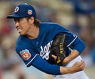 Dodgers' starting pitcher Kenta Maeda throws against the Angels during their Freeway Series game Friday night at Dodger Stadium.<br /> <br /> <br /> ///ADDITIONAL INFO:   <br /> <br /> freeway.0402.kjs  ---  Photo by KEVIN SULLIVAN / Orange County Register  --  4/1/16<br /> <br /> The Los Angeles Angels take on the Los Angeles Dodgers at Dodger Stadium during the Freeway Series Friday.<br /> <br /> <br />  4/1/16