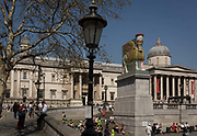 The 12th Fourth Plinth commission by the Mayor of London  artwork entitled The Invisible Enemy Should Not Exist by the artist Michael Rakowitz, in Trafalgar Square, on 19th April 2018, in London, England. Started in 2006, the sculpture recreates over 7,000 archaeological artefacts looted from the Iraq Museum during the war there or destroyed elsewhere. Oneof these was Lamassu, a winged deity which guarded Nergal Gate at the entrance to the ancient city Assyrian city of Nineveh modern-day Mosul, Iraq which was destroyed by ISIS in 2015. The Lamassu, which had the same footprint as the Fourth Plinth is made of empty Iraqi date syrup cans, representative of a once-renowned industry.