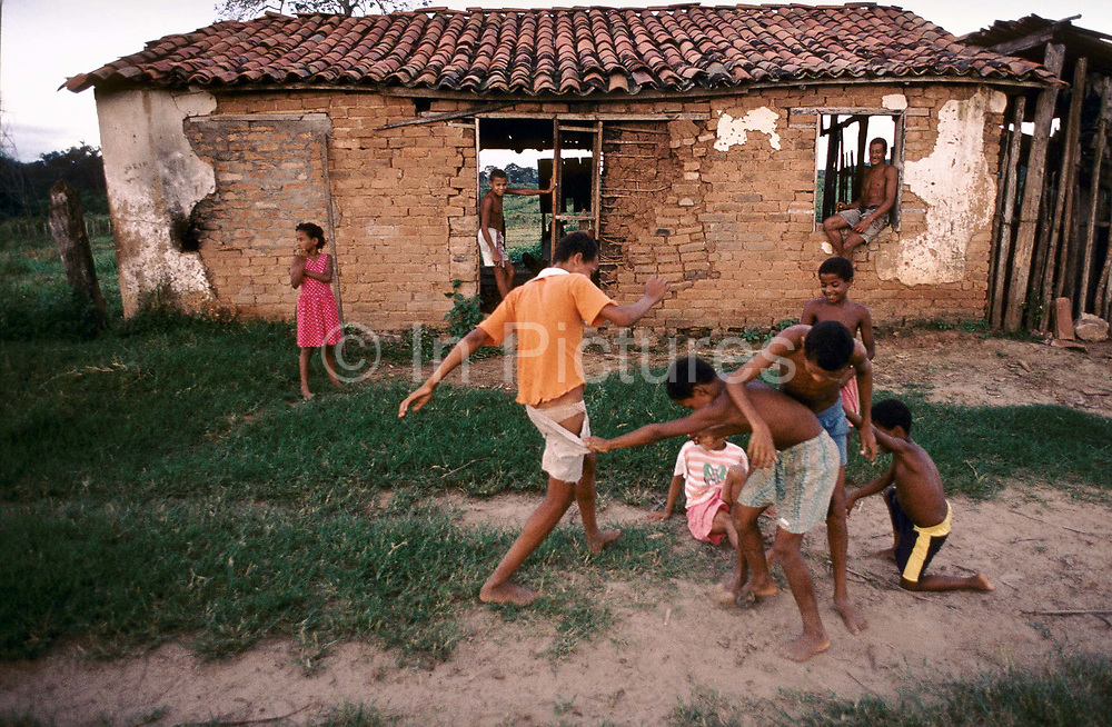 Brazil- Bahia- A group of young children playing football in what is left of an impoverished fazenda, a ranch in a poor region of north east Bahia,