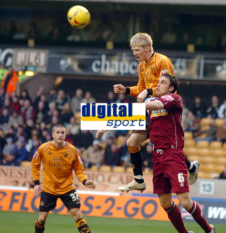 Photo: Kevin Poolman.<br />Wolverhampton Wanderers v Burnley. Coca Cola Championship. 17/02/2007. Andy Keogh of Wolves and Michael Duff both go up for a header.