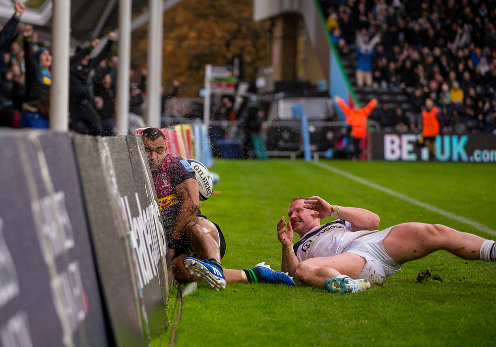 Harlequins' Joe Marchant crash into the advertising boards after scores his sides first try<br /> <br /> Photographer Bob Bradford/CameraSport<br /> <br /> Gallagher Premiership - Harlequins v Bristol Bears - Saturday 26th October 2019 - Twickenham Stoop - London<br /> <br /> World Copyright © 2019 CameraSport. All rights reserved. 43 Linden Ave. Countesthorpe. Leicester. England. LE8 5PG - Tel: +44 (0) 116 277 4147 - admin@camerasport.com - www.camerasport.com