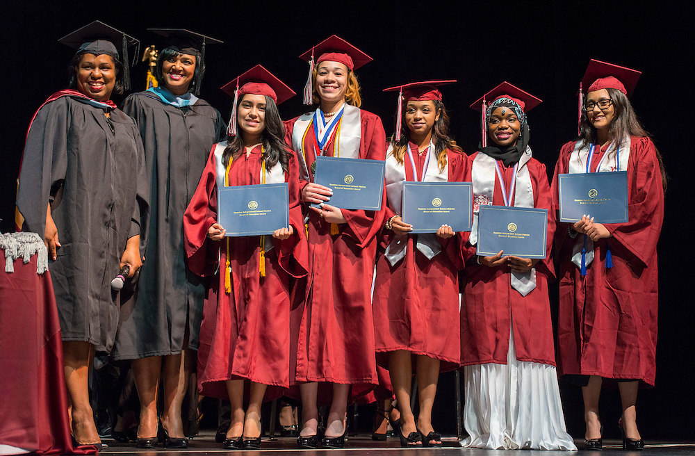 Paula Harris awards Board Recognitions during the Young Women's College Preparatory Academy graduation ceremony, May 31, 2015.