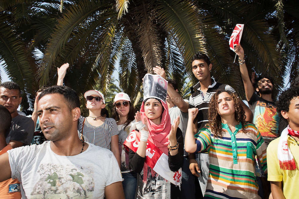 TUNIS, TUNISIA - 26 JULY 2013: Anti-government activists gather in front of the National Constituent Assemby (NCA) to chant anti-government and anti-Nidaa (opposition party) slogan, in Tunis, Tunisia, on July 26th 2013.<br /> <br /> Tunisia, birthplace of the Arab Spring revolutionary movement, was plunged into a new political crisis on Thursday when assassins shot Mohamed Brahmi, 58, leader of the Arab nationalist People's Party, an opposition party leader outside his home in a hail of gunfire.