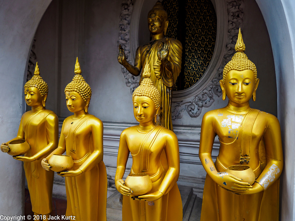 10 JULY 2018 - NAKHON PATHOM, THAILAND: Statues of the Buddha at Phra Pathom Chedi in Nakhon Pathom. Nakhon Pathom is about 35 miles west of Bangkok. It is one of the oldest cities in Thailand, archeological evidence suggests there was a settlement on the site of present Nakhon Pathom in the 6th century CE, centuries before the Siamese empires existed. The city is widely considered the first Buddhist community in Thailand and the nearly 400 foot tall Phra Pathom Chedi is considered the first Buddhist temple in Thailand.     PHOTO BY JACK KURTZ