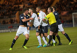 Dundee's Declan Gallagher argues with Falkirk's Phil Roberts and held back by Falkirk's Rory Loy (33).<br /> Dundee 1 v 1 Falkirk, Scottish Championship game at Dundee's home ground Dens Park.<br /> ©Michael Schofield.