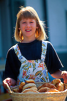 Swiss girl carrying a basket of croissants, Thalwil, Switzerland