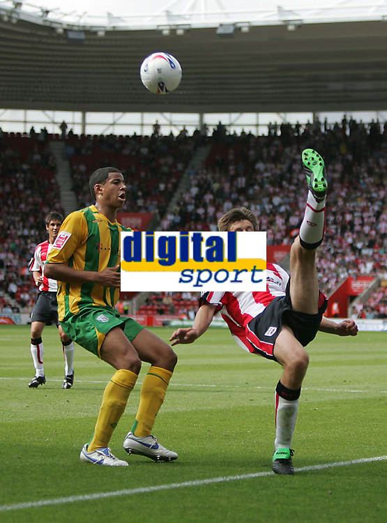 Photo: Lee Earle.<br /> Southampton v West Bromwich Albion. Coca Cola Championship. 12/08/2006. Saint's Grzegorz Rasiak (R) tries an overhead kick, watched by Curtis Davies.