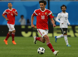 June 19, 2018 - Saint Petersburg, Russia - Yury Zhirkov of the Russia national football team vie for the ball during the 2018 FIFA World Cup match, first stage - Group A between Russia and Egypt at Saint Petersburg Stadium on June 19, 2018 in St. Petersburg, Russia. (Credit Image: © Igor Russak/NurPhoto via ZUMA Press)