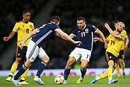 Scotland midfielder Robert Snodgrass (17) (West Ham) fends off Belgium midfielder Dries Mertens (14) (Napoli) during the UEFA European 2020 Qualifier match between Scotland and Belgium at Hampden Park, Glasgow, United Kingdom on 9 September 2019.