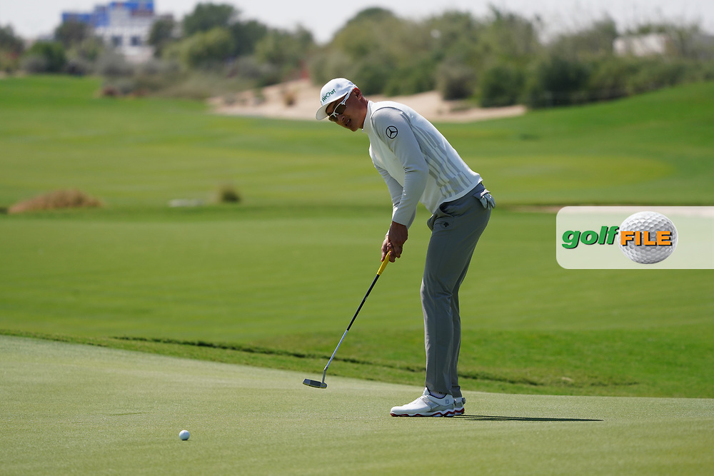 Haotong Li (CHN) on the 17th during the Pro-Am of the Commercial Bank Qatar Masters 2020 at the Education City Golf Club, Doha, Qatar . 04/03/2020<br /> Picture: Golffile | Thos Caffrey<br /> <br /> <br /> All photo usage must carry mandatory copyright credit (© Golffile | Thos Caffrey)