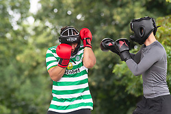 © Licensed to London News Pictures 13/08/2021. <br /> Greenwich, UK. Two men boxing in the bandstand to keep fit. A warm but cloudy day as people get out and about in Greenwich Park, London today enjoying some normality after the Coronavirus pandemic in the UK.<br /> Photo credit:Grant Falvey/LNP