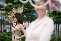 © London News Pictures. 18/06/2013. Ascot, UK.  Women in elaborate hats on day one of Royal Ascot at Ascot racecourse in Berkshire, on June 18, 2013.  The 5 day showcase event,  which is one of the highlights of the racing calendar, has been held at the famous Berkshire course since 1711 and tradition is a hallmark of the meeting. Top hats and tails remain compulsory in parts of the course. Photo credit should read: Ben Cawthra/LNP