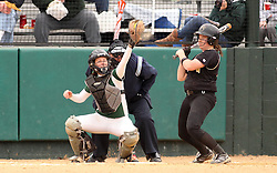 30 March 2013:  Kaity Crane catches during an NCAA Division III women's softball game between the DePauw Tigers and the Illinois Wesleyan Titans in Bloomington IL<br /> <br /> Umpire is Jay MacDaniels of Pekin IL