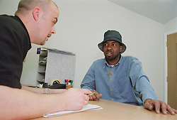 Keyworking session between project worker and resident of homeless hostel,