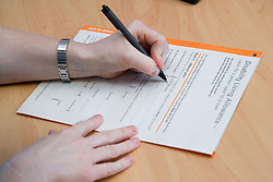 Filling in Disability Living Allowance form at the Nottinghamshire Deaf Society,