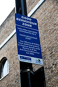Quaker Street, Bethnal Green, London. Sign saying 'Good behaviour zone' , an effort to combat the excessive drinking that occurs in the neighborhood