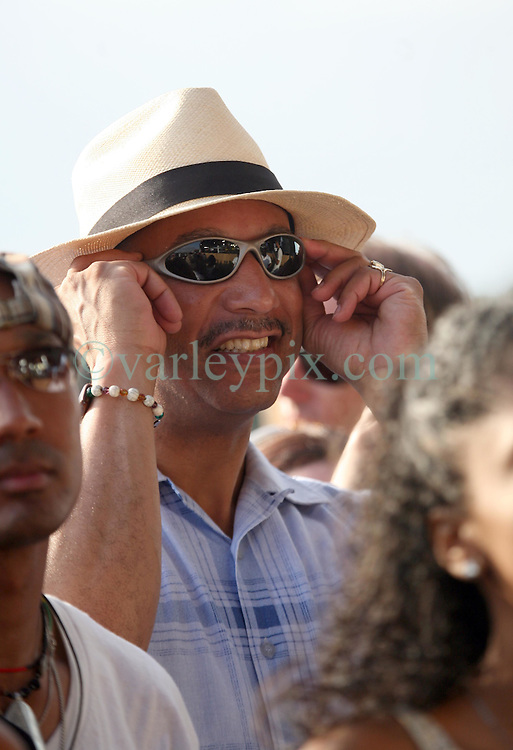 April 26 2009. New Orleans, Louisiana. The New Orleans Jazz and Heritage Festival. Embattled New Orleans mayor Ray Nagin attends the festival almost incognito as he enjoys a relaxing day at the festival listening to Earth Wind and Fire. <br /> Photo; Charlie Varley/varleypix.com