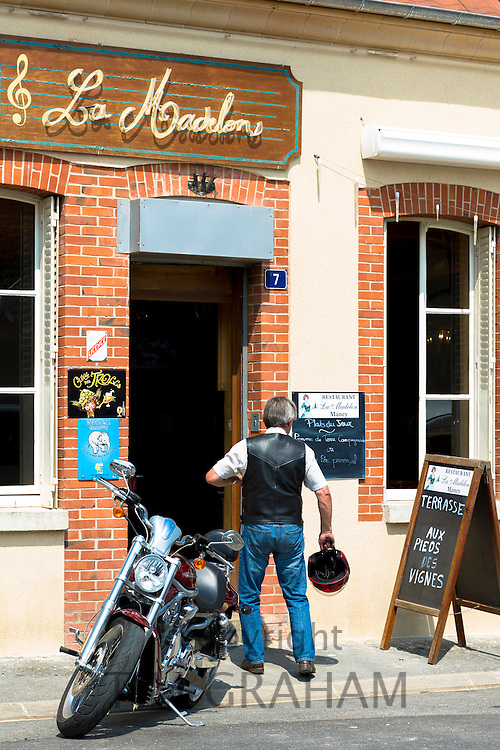 French man with Harley Davidson Motorbike at Bar La Madelon on the Champagne Tourist Route at Mancy, Champagne-Ardenne, France