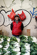 A vegetable vendor in Chinatown in New York City.