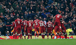 Liverpool's Mohamed Salah (obscured) celebrates scoring his side's first goal of the game during the UEFA Champions League, Quarter Final at the Etihad Stadium, Manchester.