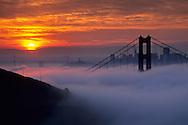 Golden Gate Bridge and fog at sunrise from the Marin Headlands, California