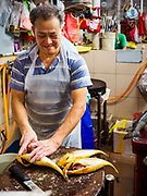 11 DECEMBER 2018 - SINGAPORE:  A fish monger in the Haig Road Market and Food Centre in the Geylang neighborhood. The Geylang area of Singapore, between the Central Business District and Changi Airport, was originally coconut plantations and Malay villages. During Singapore's boom the coconut plantations and other farms were pushed out and now the area is a working class community of Malay, Indian and Chinese people. In the 2000s, developers started gentrifying Geylang and new housing estate developments were built.     PHOTO BY JACK KURTZ
