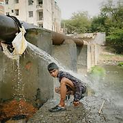 Omba Samir, recycler, drug user. Open air sewages below the Barapullah road in Nizamudin.