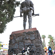 Bicycle leaning against military memorial statue at El Tour de Tucson 2011 finish. Bike-tography by Martha Retallick.
