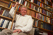 Surrounded by books is British Roman Catholic journalist, historian, speechwriter and author, Paul Johnson on 21st February 1992 in London England. Paul Bede Johnson b1928 is an English journalist, historian, speechwriter and author. He was educated at the Jesuit independent school Stonyhurst College, and at Magdalen College, Oxford. Johnson first came to prominence in the 1950s as a journalist writing for, and later editing, the New Statesman magazine. A prolific writer, he has written over 40 books and contributed to numerous magazines and newspapers. While associated with the left in his early career, he is now a conservative popular historian.