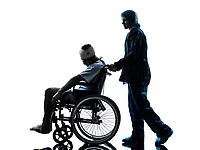 one injured man in wheelchair sleeping in silhouette studio on white background