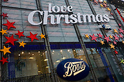 The words 'Love Christmas at Boots' are spread across the frontage window of the Boots branch in London's Oxford Street. The Boots brand name appears twice on the window along with red and yellow stars. Boots UK Limited (commonly known as Boots, previously The Boots Company), is a leading pharmacy chain in the United Kingdom, with outlets in most high streets throughout the country. Boots was established in 1849, by John Boot. After his father's death in 1860, Jesse Boot, aged 10 helped his mother run the family's herbal medicine shop in Nottingham, England.