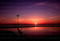 SUNSETS OVER THE SOLENT AT WEST WITTERING, WEST SUSSEX, ENGLAND. PHOTO BY TERRY FINCHER