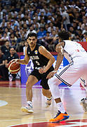 NANJING,CHINA:SEPTEMBER 5th 2019.FIBA World Cup Basketball 2019 Group phase match.Group F. New Zealand vs Greece.Point Guard,Shea ILI (L) tries to pass by Greek player Small Forward Giannis ANTETOKOUNMPO.<br /> Photo by Jayne Russell / www.PhotoSport.nz