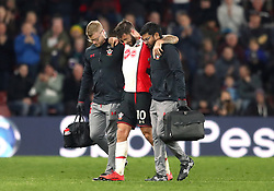 Southampton's Charlie Austin limps off injured during the Premier League match at St Mary's, Southampton.
