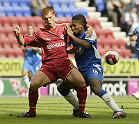 Photo: Aidan Ellis.<br /> Wigan Athletic v Reading. The Barclays Premiership. 26/08/2006.<br /> Reading's Steve Sidwell (L) and Wigan's Antonio Valencia battle for possesion