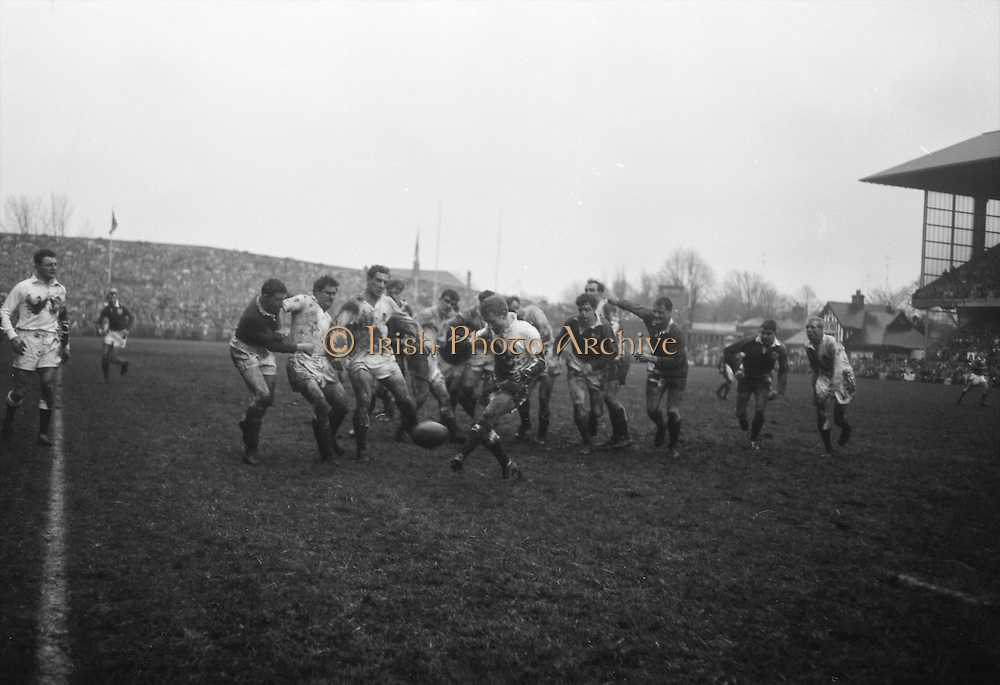 J E Owen, England, kicks for touch under pressure,..Irish Rugby Football Union, Ireland v England, Five Nations, Landsdowne Road, Dublin, Ireland, Saturday 9th February, 1963,.9.2.1963, 2.9.1963,..Referee- H B Laidlaw, Scottish Rugby Union, ..Score- Ireland 0 - 0 England, ..Irish Team, ..B D E Marshall, Wearing number 15 Irish jersey, Full Back, Queens University Rugby Football Club, Belfast, Northern Ireland,..W R Hunter, Wearing number 14 Irish jersey, Right Wing, C I Y M S Rugby Football Club, Belfast, Northern Ireland, ..J C Walsh,  Wearing number 13 Irish jersey, Right Centre, University college Cork Football Club, Cork, Ireland,..P J Casey, Wearing number 12 Irish jersey, Left Centre, University College Dublin Rugby Football Club, Dublin, Ireland, ..N H Brophy, Wearing number 11 Irish jersey, Left wing, Blackrock College Rugby Football Club, Dublin, Ireland, ..M A English, Wearing number 10 Irish jersey, Stand Off, Landsdowne Rugby Football Club, Dublin, Ireland, ..J C Kelly, Wearing number 9 Irish jersey, Scrum Half, University College Dublin Rugby Football Club, Dublin, Ireland,..R J McLoughlin, Wearing number 1 Irish jersey, Forward, Blackrock College Rugby Football Club, Dublin, Ireland, ..A R Dawson, Wearing number 2 Irish jersey, Forward, Wanderers Rugby Football Club, Dublin, Ireland, ..S Millar, Wearing number 3 Irish jersey, Forward, Ballymena Rugby Football Club, Antrim, Northern Ireland,..W A Mulcahy, Wearing number 5 Irish jersey, Captain of the Irish team, Forward, Bective Rangers Rugby Football Club, Dublin, Ireland,  ..W J McBride, Wearing number 5 Irish jersey, Forward, Ballymena Rugby Football Club, Antrim, Northern Ireland,..E P McGuire, Wearing number 6 Irish jersey, Forward, University college Galway Football Club, Galway, Ireland,..C J Dick, Wearing number 8 Irish jersey, Forward, Ballymena Rugby Football Club, Antrim, Northern Ireland,..M D Kiely, Wearing number 7 Irish jersey, Forward, Landsdowne Rugby Football Club, Dublin, Ireland, ..E