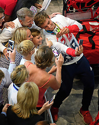 © Licensed to London News Pictures. 23/08/2016. London, UK. Olympic bronze medal diver TOM DALEY poses for a picture with members of the public as Team GB arrives at terminal 5 of London Heathrow Airport on British Airways flight BA2016, decorated with a gold nose. Team GB finished second in the medals table with 67 medals, beating their total of 65 at London 202.  Photo credit: Ben Cawthra/LNP