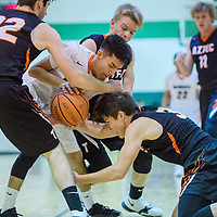 Wingate Bear Matthew Begay (11) wrestles the ball away from the Aztec Tigers Tuesday at Wingate High School.