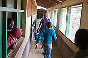 Children running down the corridors at break time in Kibera School in the slums of Kibera, Nairobi, Kenya.