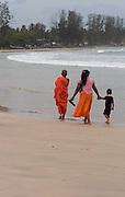 Buddhist Family on Beach in Sri Lanka