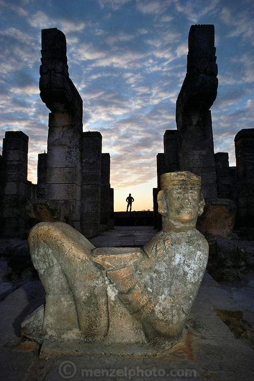 "A Chac Mool statue on the Temple of the Warrior at Chichen Itza or ""at the mouth of the well of the Itza"". Mayan ruins in Yucatan, Mexico. These were believed to be receptacles for incense and human hearts during sacrifices."