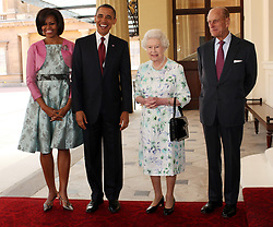 US President Barack Obama and First Lady Michelle Obama with Queen Elizabeth II and the Duke of Edinburgh on the steps of Buckingham Palace during the Obama's state visit to the UK and Ireland.